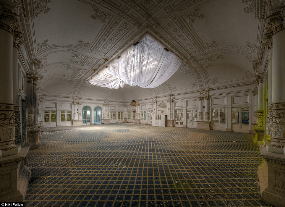 Delusions of grandeur: This colonnaded ball room decked out in marble looks like it could be the site of a grand reception, if it weren