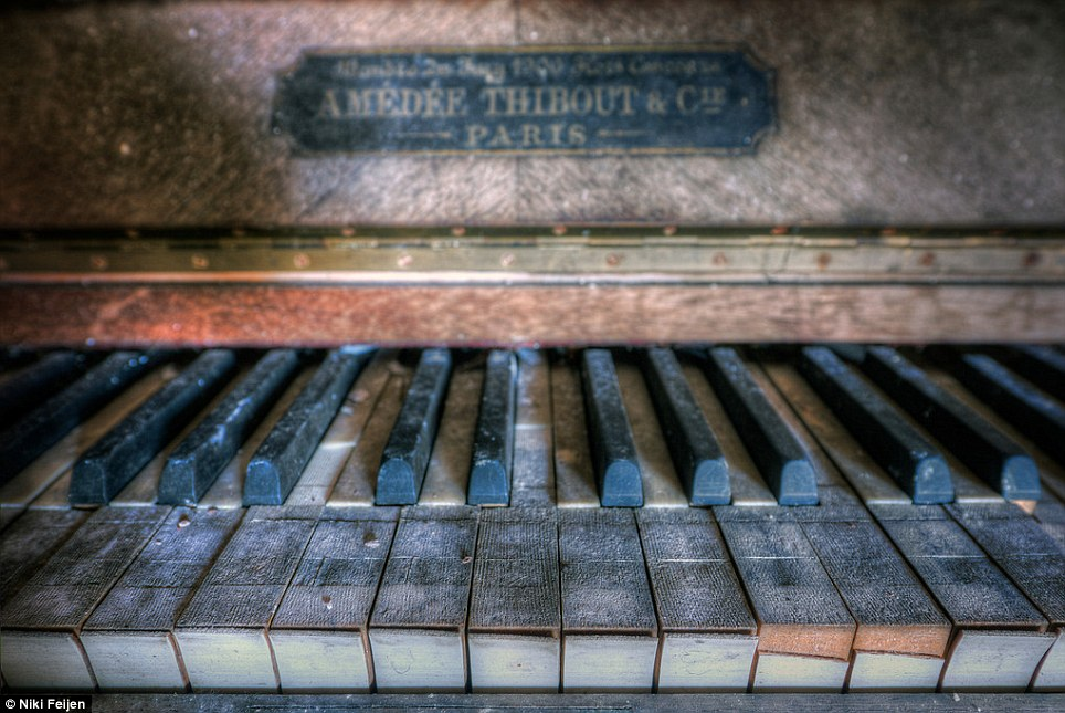 Phantom music: The keys on this dusty old piano clearly have not been touched for many years